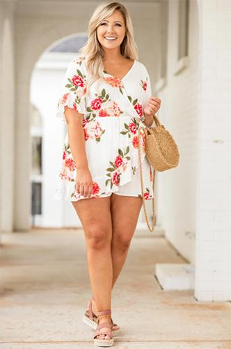 a full figured woman wearing an allow me to reintroduce myself romper in white