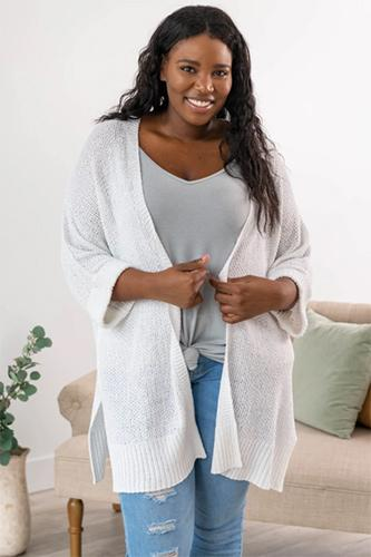 a full figured woman sporting a real life problem cardigan in ivory