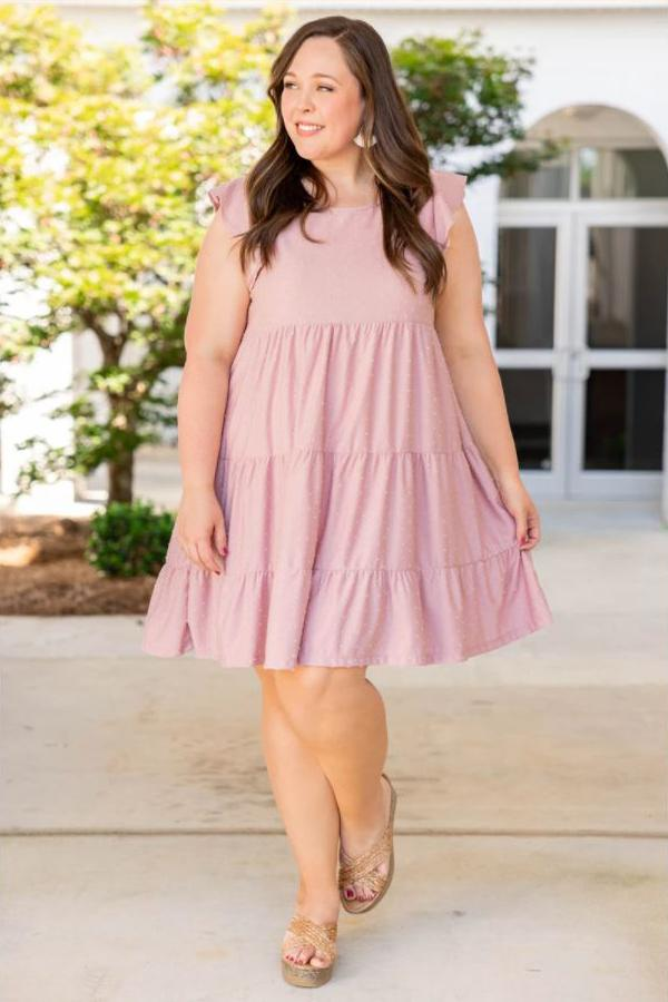 a full figured woman wearing a sweet as can be dress in mauve