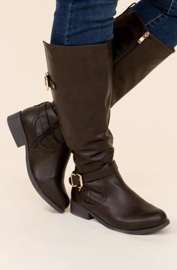 a pair of wander through aspen boots in brown