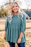 shirt, three quarter sleeve, babydoll, flowy, ruffle hem, bubble sleeves, longer back, back slit, green, comfy